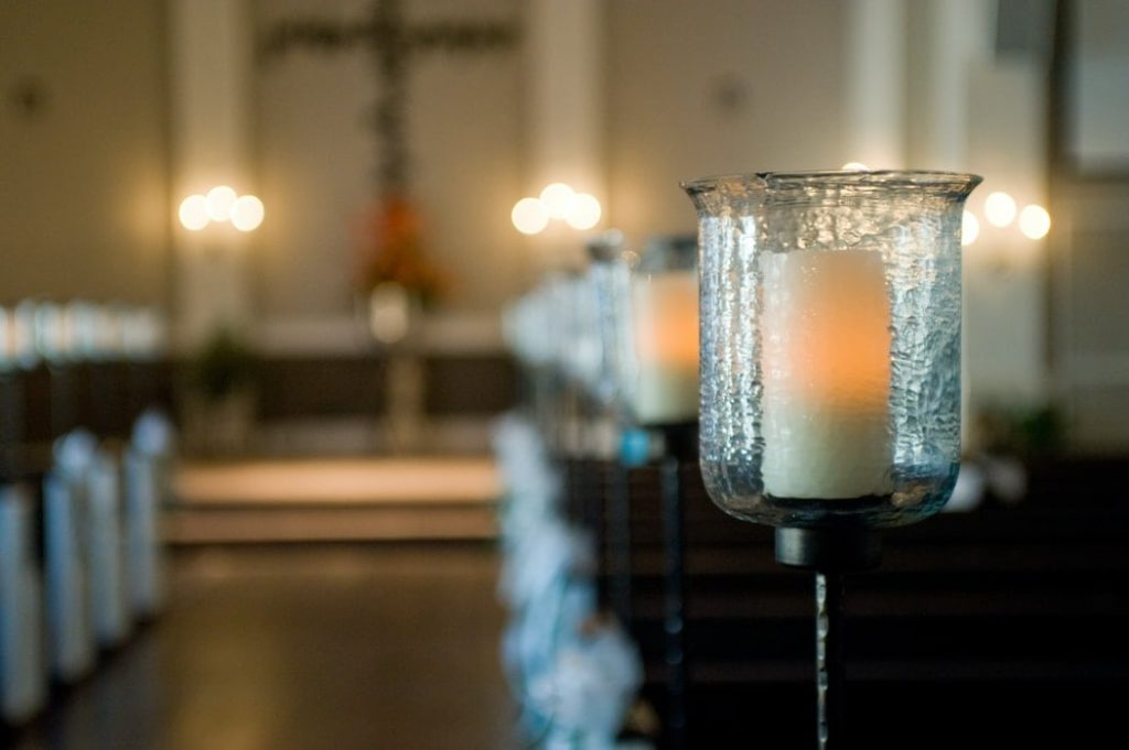 candle in the back of a church